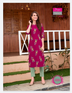 dark pink kurti - rayon with classy print & fancy embroidery work   pant - rayon lacyra print with pocket style  fabric printed + embroidery work casual