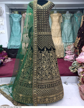 green fancy fabric embroidery + stone work wedding