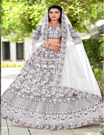 white lehenga -net embroidery diamond stone work |inner- satin silk with cancan |dupatta -net |blouse -net |waist -44+ |length -42+ |flair -2.40m |type -semi stitched fabric embroidery work running