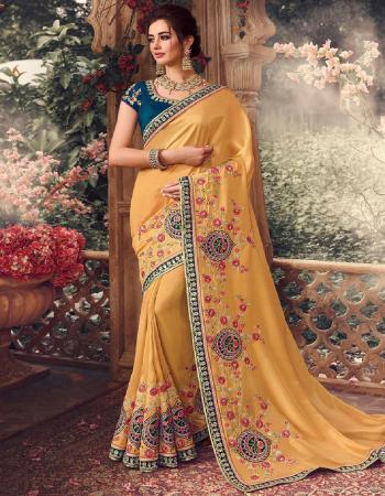 orange saree - rangoli silk | blouse - banglori & work | saree length - 5.5 m | blouse - 0.80 m | [ master copy ] fabric embroidery work casual